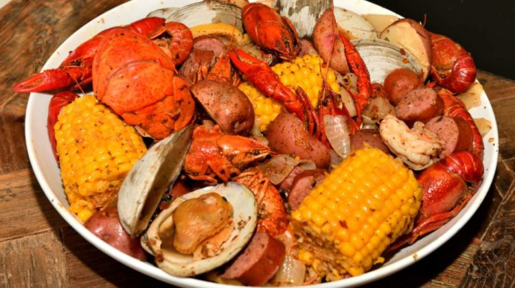 cajun style seafood boil on serving | New England Clam Bake Recipe | Homemade Recipes | featured