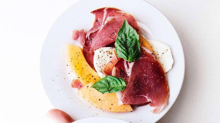 vLv9bQzykIA-two raw meats on white ceramic plates-prosciutto-us-feature