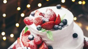 close up photography tier vanilla cake with blueberry and strawberry | Winter Cakes You Must Try This​ Winter​ Season | Featured