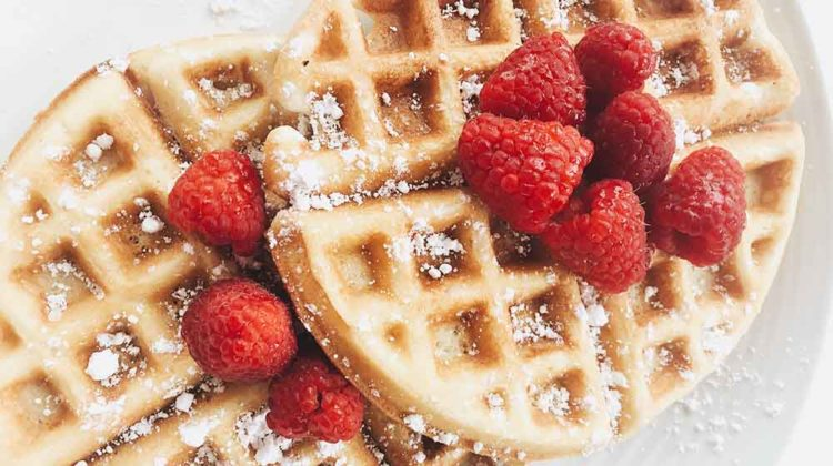 red strawberries on brown waffles | Waffle Iron Recipes To Make With Your Waffle Maker | Featured