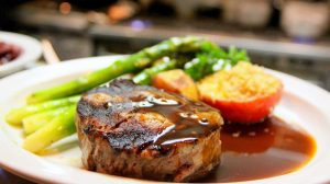 selective focus photography of beef steak with sauce-oven baked pork chops-px-feature