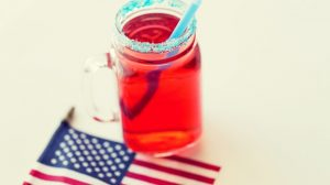juice glass and american flag on independence day | DIY Cocktails For Your 4th Of July Party | Featured