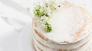 Rustic wedding cake with white lilac, light background | Simple Vanilla Naked Cake Recipe With Buttercream Frosting | half naked cake | Featured