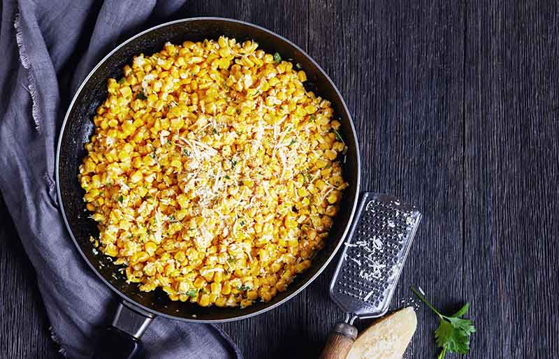 parmesan rancho corn skillet on dark | soul food dinner menu