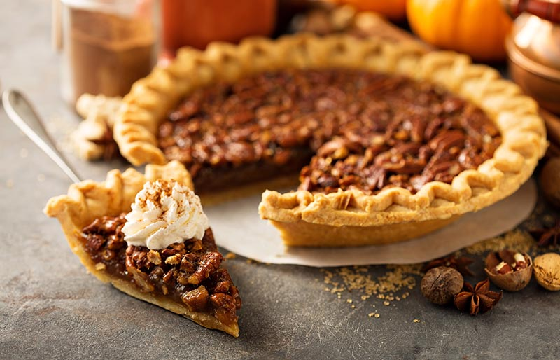 traditional pecan pie fall dessert concept | soul food dinner menu