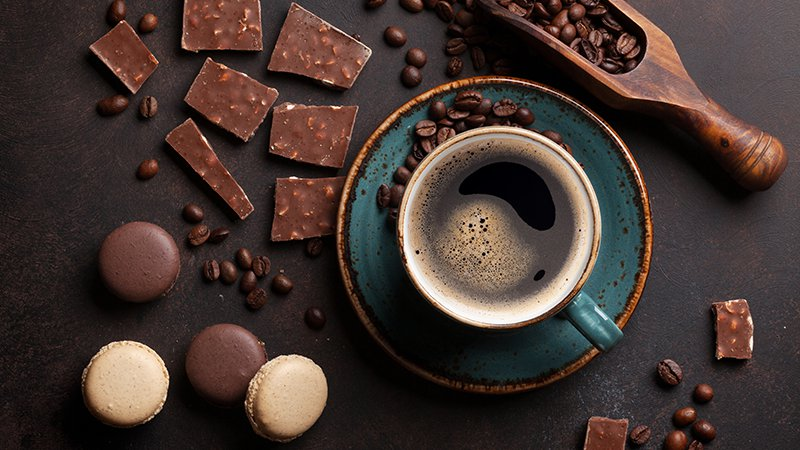 Coffee cup, beans, chocolate and macaroons on old kitchen table | Stock-Up Grocery List And Recipes To Cook For Coronavirus Quarantine | Staple food