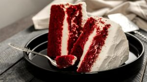 slices delicious red velvet cake on | Red Velvet Ice Cream Cake Recipe That Will Melt Your Stress Away | featured